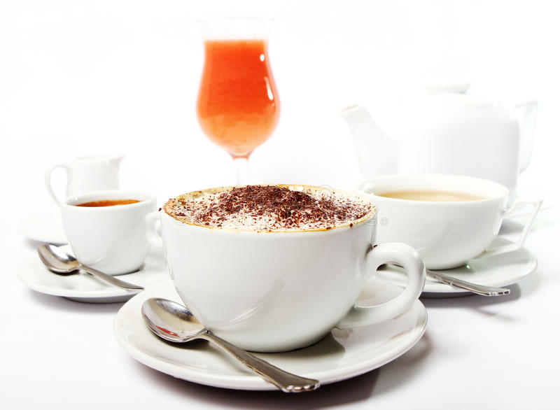 Breakfast table with beverges. Breakfast table with coffe, tea and juice royalty free stock photos
