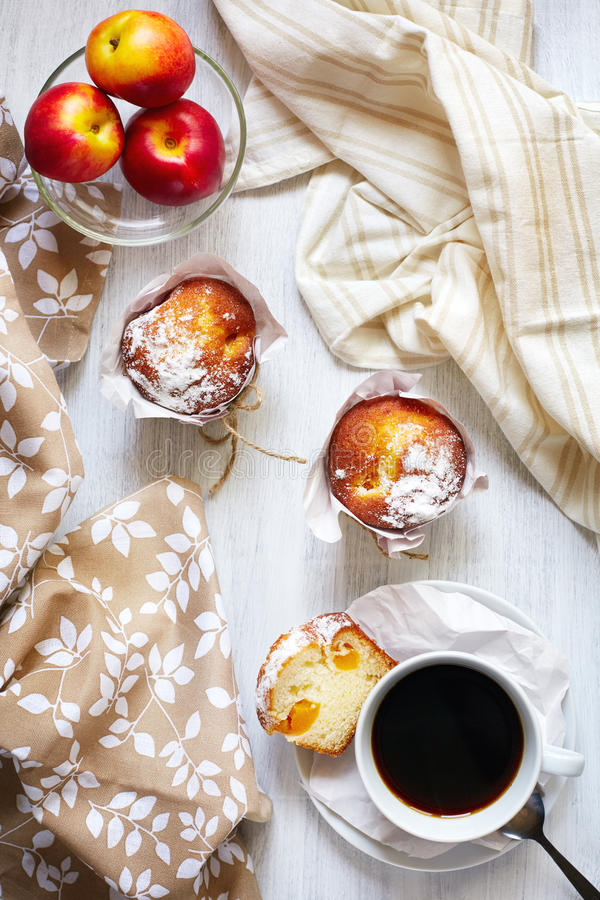 Breakfast table with cakes, coffee and fruits royalty free stock photos