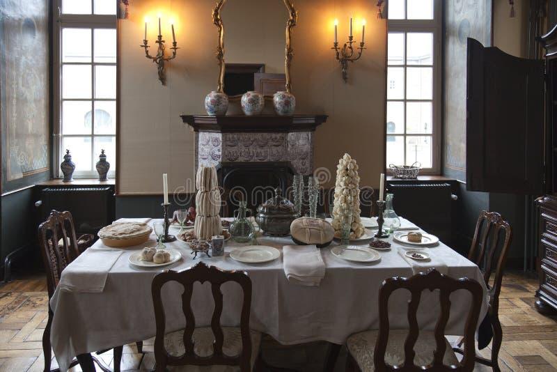 Breakfast table in historic ambience of the castle. Breakfast room in a medieval setting of kasteelHhoensbroek royalty free stock photos
