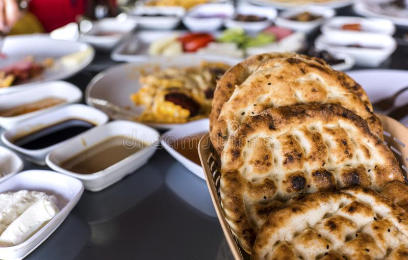 Breakfast table with lots of variable foods with Turkish Ramadan flat bread, close up, food photography stock photos