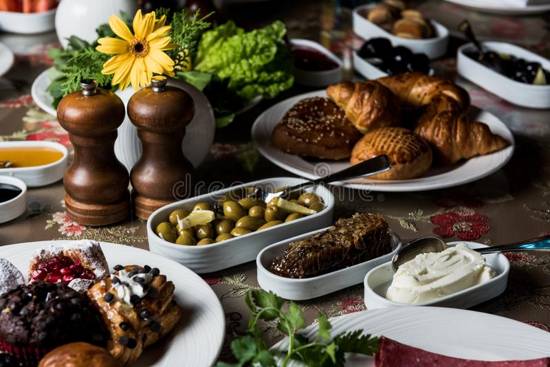 Breakfast table. Luxury and rich foods like orange juices. Cakes and also some desserts royalty free stock photography
