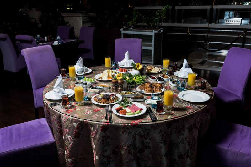 Breakfast table. Luxury and rich foods like patties, salamies and orange juices stock image