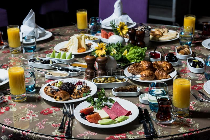 Breakfast table. Luxury and rich foods like patties, salamies and orange juices stock photo