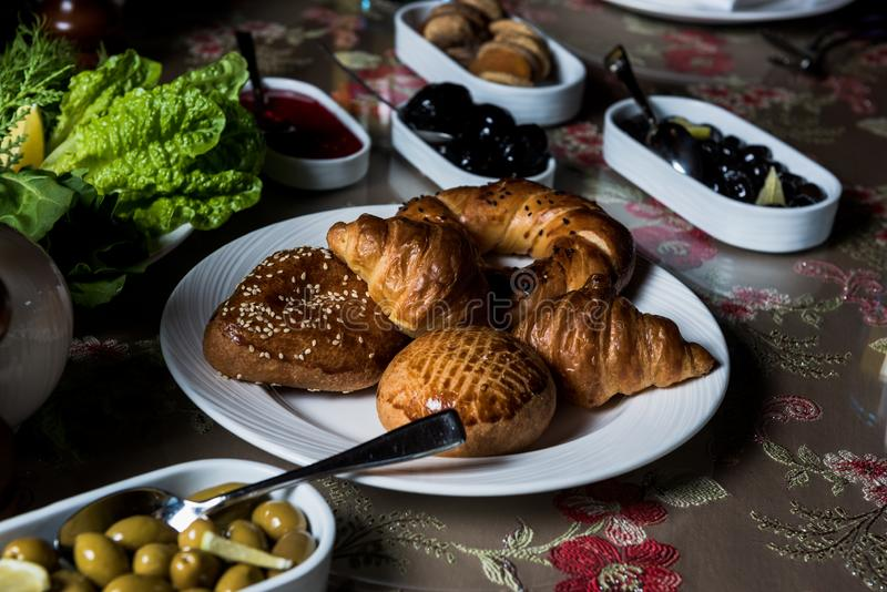 Breakfast table. Luxury and rich foods like salamies. Cakes and also some desserts stock photos
