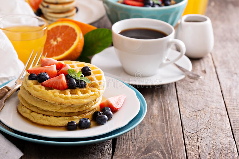 Breakfast table with stack of waffles royalty free stock photo
