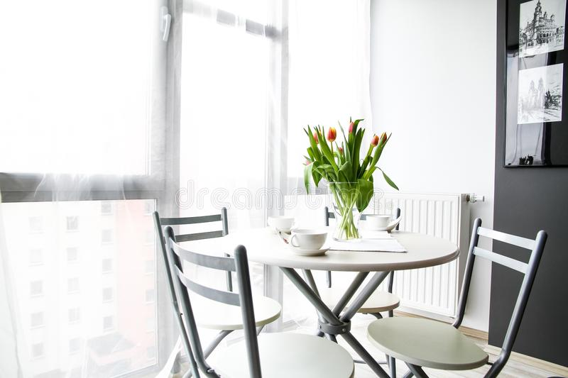 Breakfast table in sunny room royalty free stock image