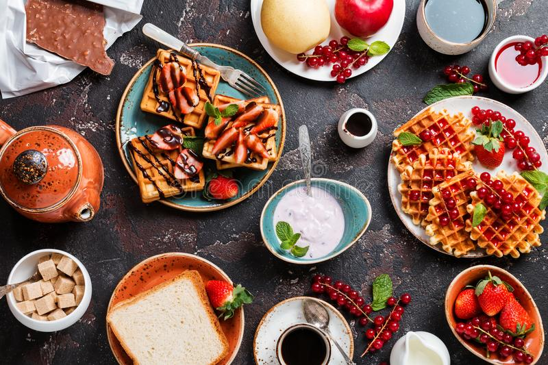 Breakfast table with waffles stock photography
