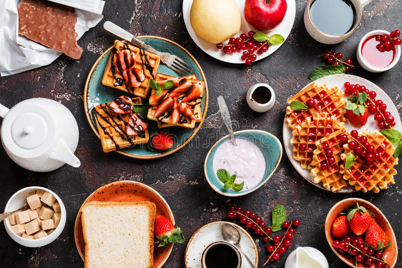Breakfast table with waffles stock photos