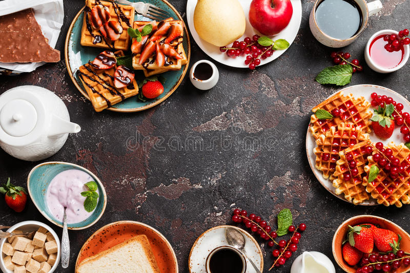 Breakfast table with waffles royalty free stock images
