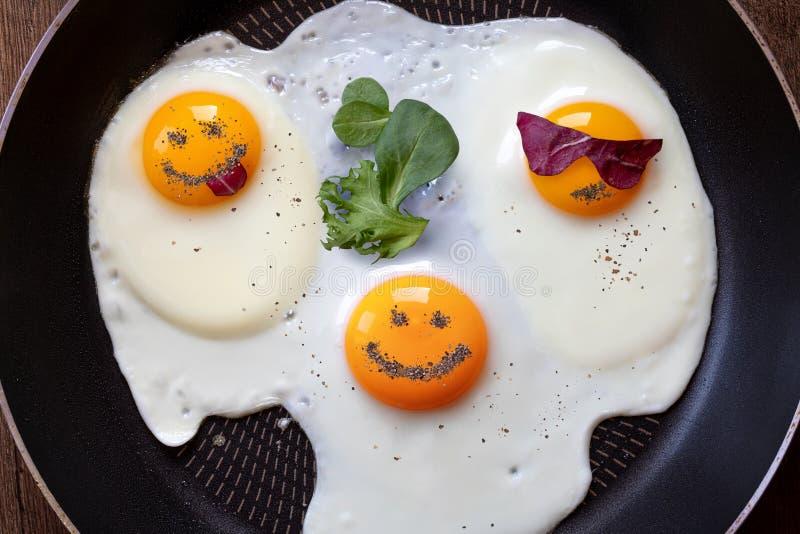 Three fried eggs like emoticons. Breakfast of three fried eggs like emoticons royalty free stock photo