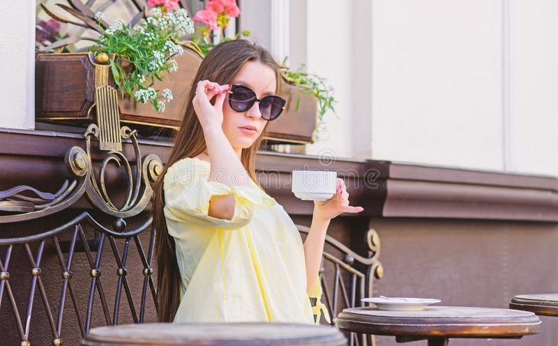 Breakfast time in cafe. Girl enjoy morning coffee. Waiting for date. Woman in sunglasses drink coffee outdoors. Girl stock images