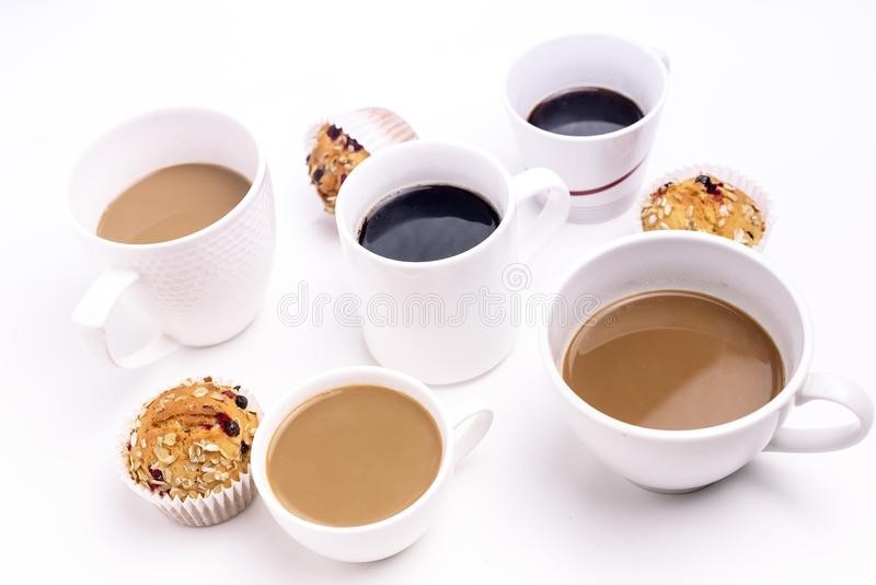 Breakfast Time Concept Different Coffee Mugs Muffins Cupcakes Above White Background Black Coffee Coffe with Milk royalty free stock image