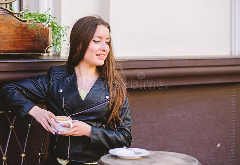 Breakfast time. girl relax in cafe. Business lunch. summer. Just relaxing. Meeting in cafe. happy girl. stylish woman in. Leather jacket drink coffee. morning royalty free stock photography