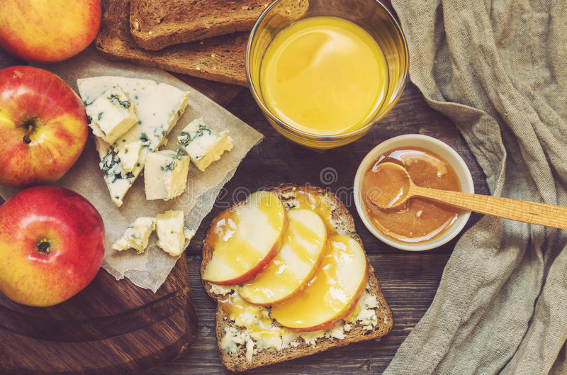 Breakfast toast with apple, honey and gorgonzola cheese stock photos