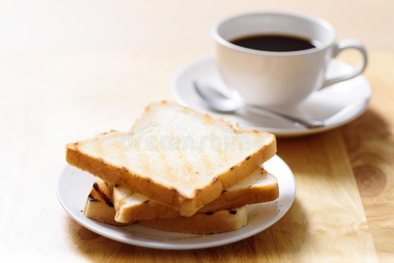 Breakfast with toast and coffee on wooden table royalty free stock photography