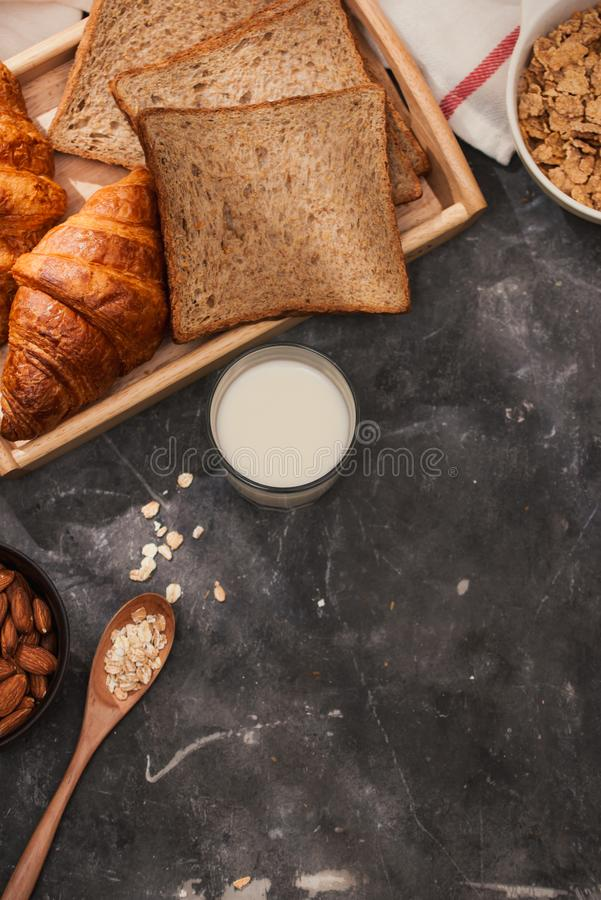 Breakfast with toast and croissant. milk in a glass bottle. Good start to the day. Good morning.  stock images