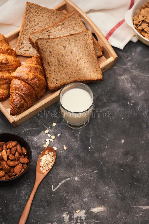 Breakfast with toast and croissant. milk in a glass bottle. Good start to the day. Good morning.  stock image