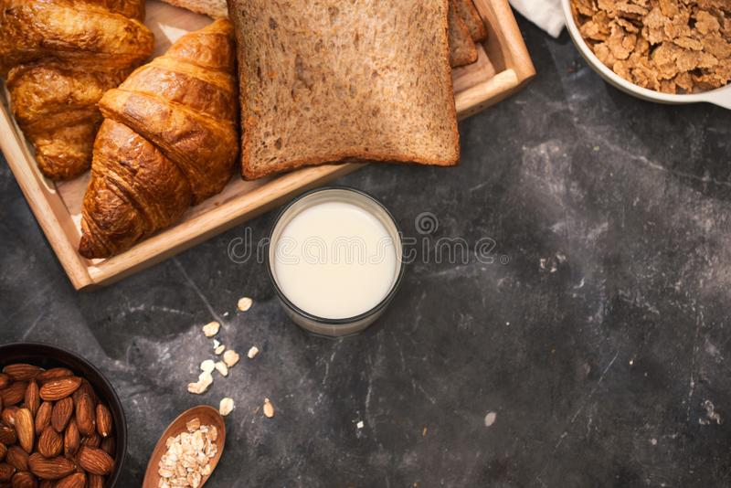 Breakfast with toast and croissant. milk in a glass bottle. Good start to the day. Good morning.  royalty free stock photography