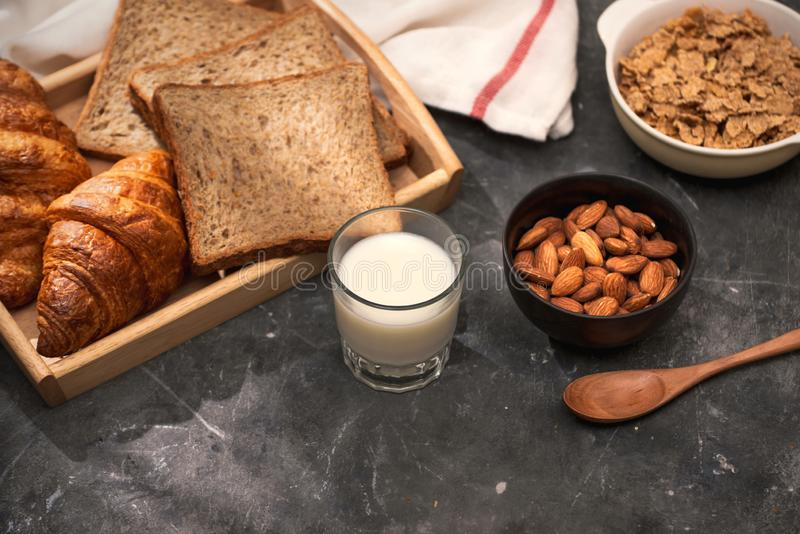 Breakfast with toast and croissant. milk in a glass bottle. Good start to the day. Good morning.  stock photos