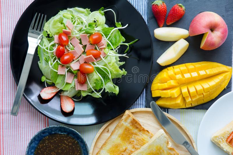 Breakfast. Toast and vegetable salad with fruit stock images