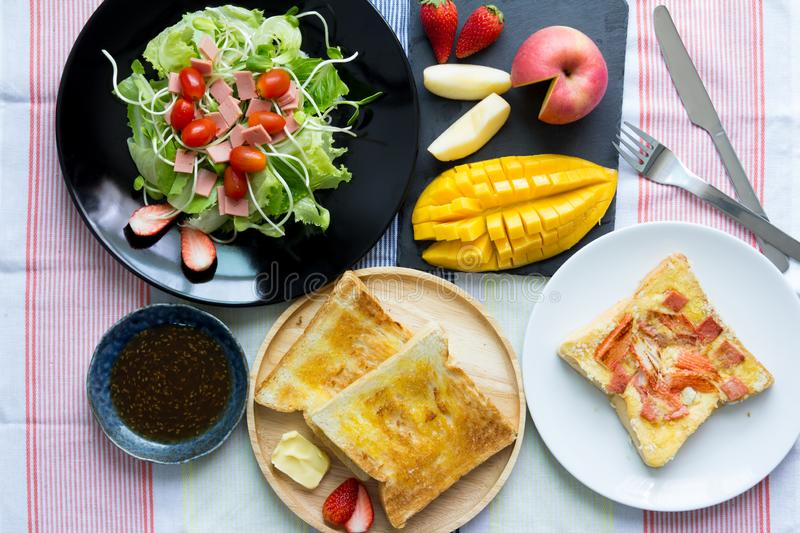 Breakfast. Toast and vegetable salad with fruit royalty free stock photos