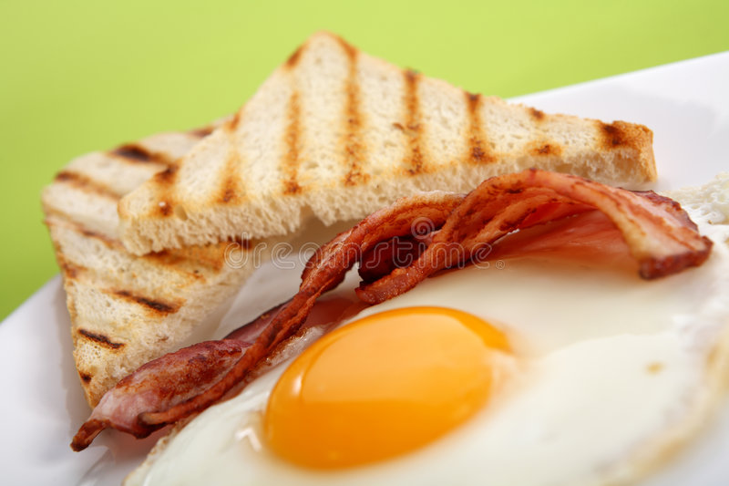 Breakfast - toasts, eggs, bacon. Breakfast concept - toasts, eggs, bacon royalty free stock images