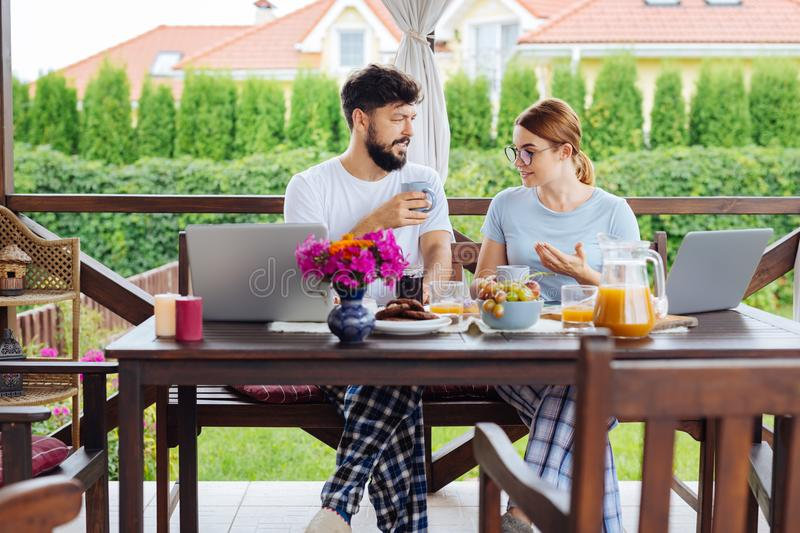 Happy couple of businessmen having delicious breakfast together stock images