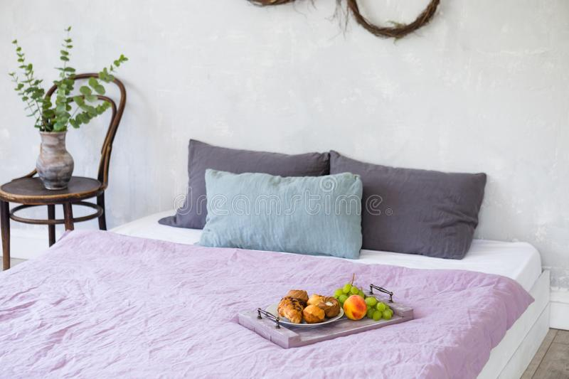 Breakfast on tray in bed in cozy hotel room. royalty free stock images