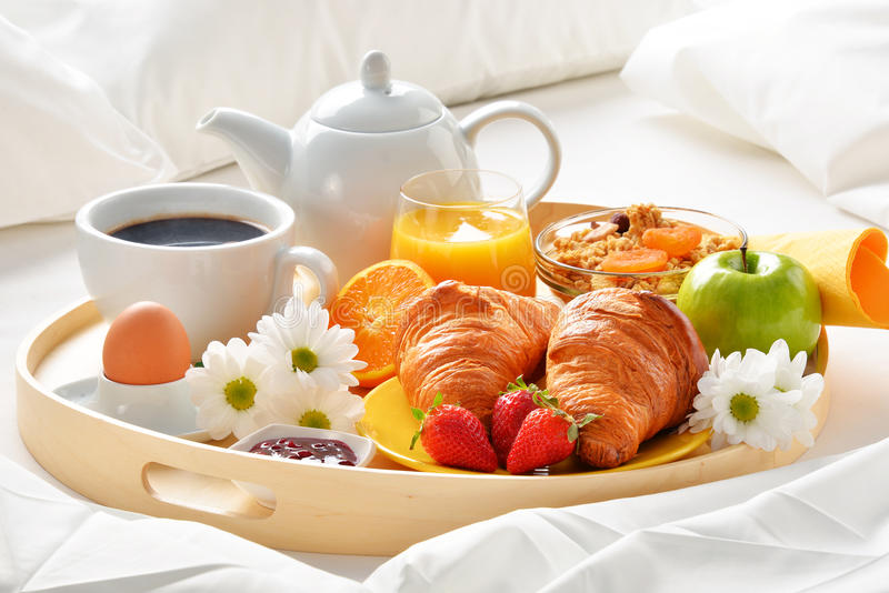 Breakfast tray in bed in hotel room stock images