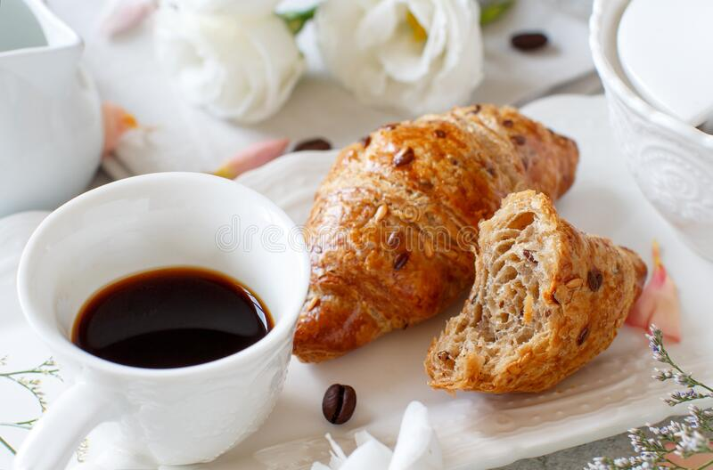 Breakfast tray with coffee cup and croissant stock images