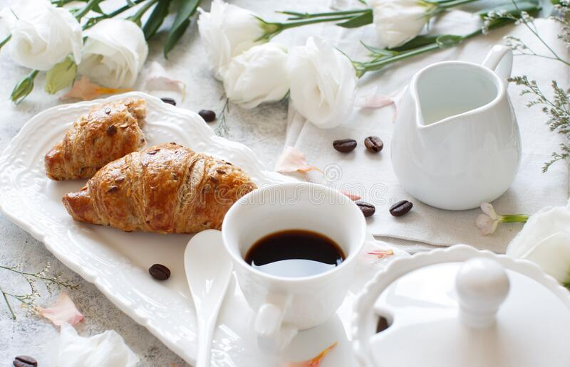 Breakfast tray with coffee cup and croissant stock photo