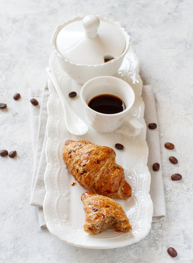 Breakfast tray with coffee cup and croissant stock photos