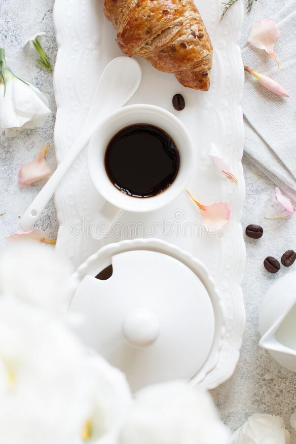 Breakfast tray with coffee cup and croissant royalty free stock images