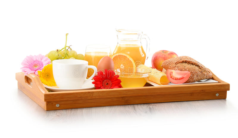 Breakfast on tray served with coffee, juice, egg, and rolls stock photography