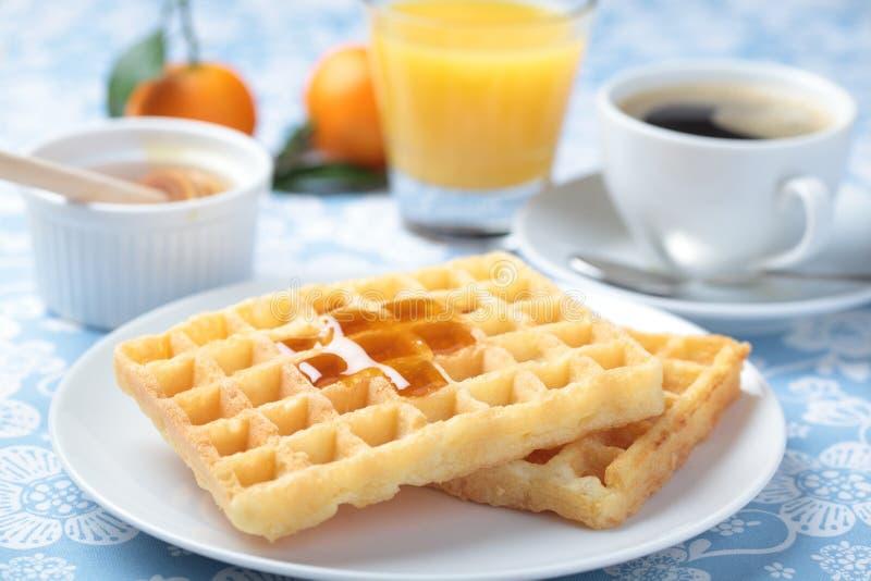 Breakfast with waffles. Breakfast with Belgian waffles, honey, orange juice and coffee stock image