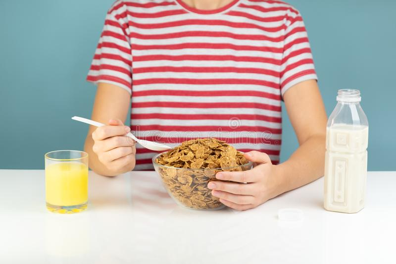 Breakfast with whole grain cereals, milk and juice royalty free stock photo