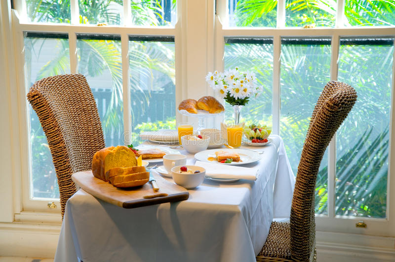 Breakfast by the window. Fine dining at breakfast time royalty free stock images