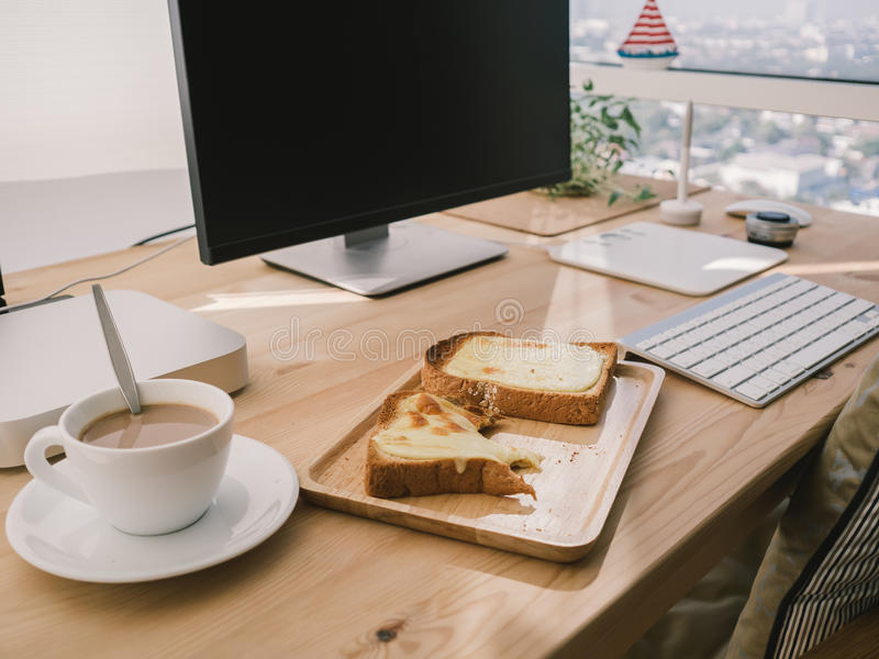 Breakfast on work. Breakfast and work at the same time royalty free stock photo
