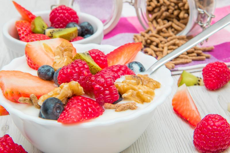 Breakfast with yogurt,strawberry rasperry and cereals stock images