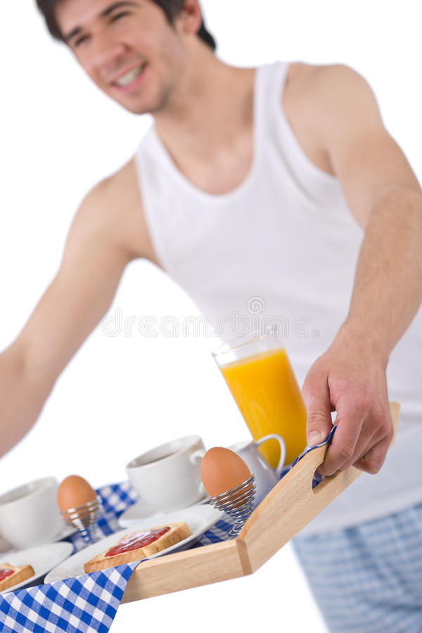 Breakfast - Young Man Holding Tray Toast And Juice Royalty Free Stock Photos