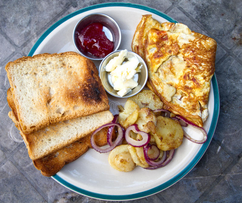 Breakfast. Yummy breakfast with omelette and potatoes royalty free stock photos