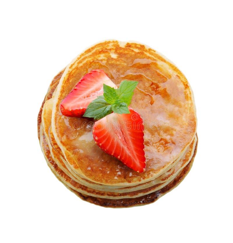 BreakfastPancakes с клубникой и медом стоковая фотография