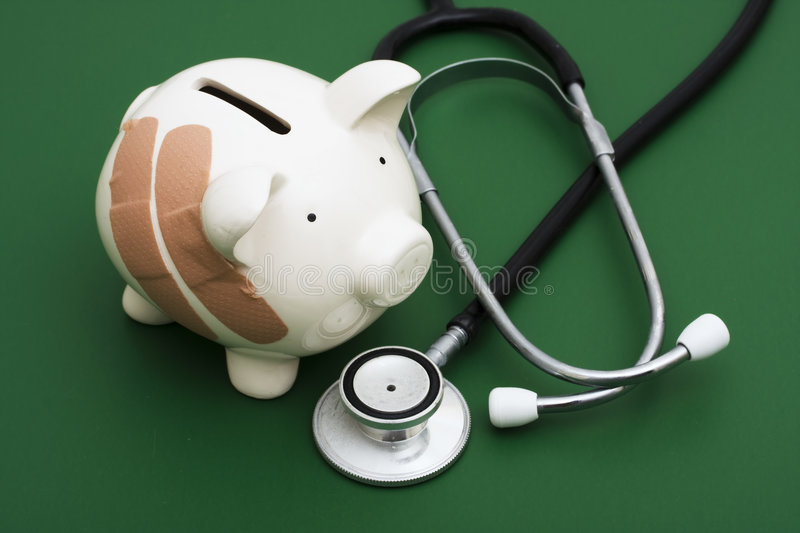 Breaking the Bank. Piggy bank with adhesive bandage, the health of your finances royalty free stock photo