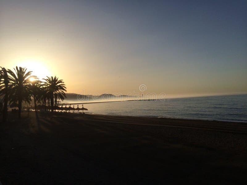 Breaking dawn. Málaga boardwalk royalty free stock photos