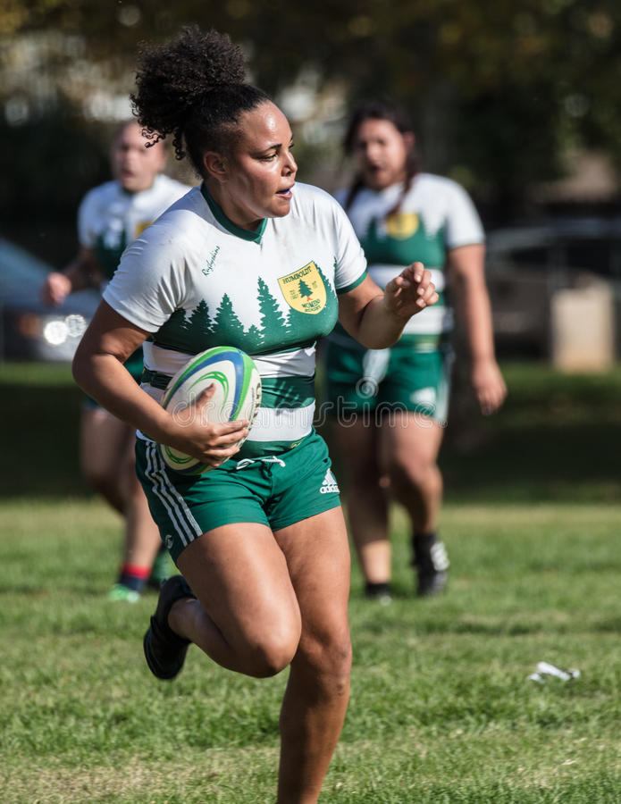 Breaking Through. Female rugby action in Redding, California royalty free stock photography