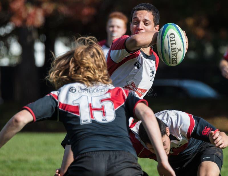 Breaking Through. Men`s rugby action in Redding, California stock image