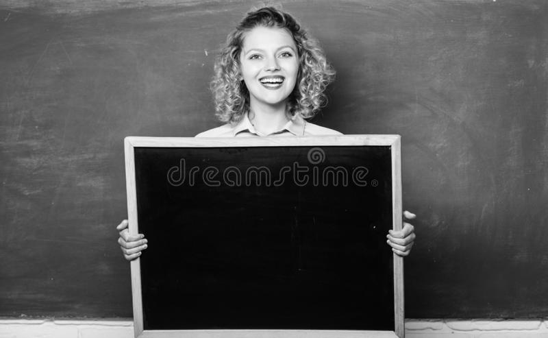 Breaking news. Teacher cheerful woman hold blackboard blank copy space. School information concept. School bell schedule. Information. Remember this information royalty free stock photo