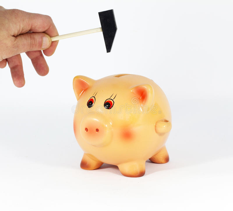 Breaking piggy bank royalty free stock images