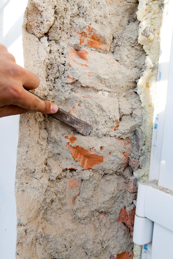 Breaking plaster during the reconstruction of the house. royalty free stock image