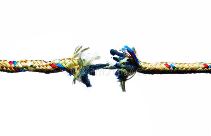 Breaking rope. Colorful cut and frayed rope about to break on white background royalty free stock photography